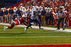 NORMAL, IL - September 21: Luther Kirk lunges at the legs of Joe Logan during a college football game between the ISU (Illinois State University) Redbirds and the Northern Arizona University (NAU) Lumberjacks on September 21 2019 at Hancock Stadium in Normal, IL. (Photo by Alan Look)