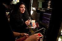 """Sophie Novak, 17, of Vancouver, Canada collects merchandise in the gift shop at the """"Harry Potter"""" exhibition at Discovery Times in New York. ..Photo by Robert Caplin."""
