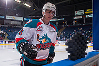 KELOWNA, CANADA - APRIL 14: Kole Lind #16 of the Kelowna Rockets stands at the boards to clear pucks to the ice for warm up against the Portland Winterhawks on April 14, 2017 at Prospera Place in Kelowna, British Columbia, Canada.  (Photo by Marissa Baecker/Shoot the Breeze)  *** Local Caption ***