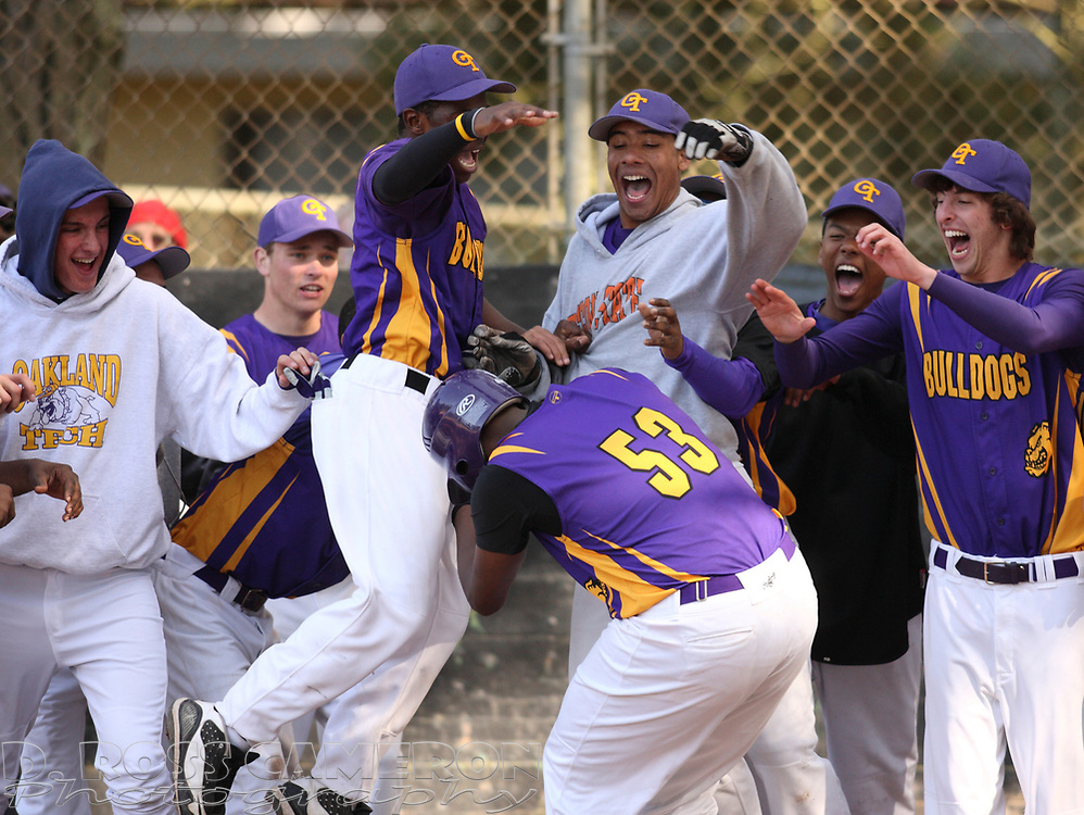 Oakland Technical High School players mob Kelvin McMiller (53) after he hit a solo home run to tie the score in the fourth inning of an Oakland Athletic League high school baseball game, Wednesday, April 14, 2010 in Oakland, Calif. (D. Ross Cameron/Staff)