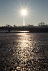 The sun, a light pole, and a car all ligned up for this shot on a morning near Lake Nokomis