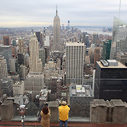 A panoramic view of Manhattan, New York, from the Top of the Rock, the observatory deck at Rockefeller Center showing the Empire State Building, Manhattan, New York, USA. Photo Tim Clayton