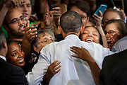 """President Obama hosts a town hall meeting at University of Maryland on Friday to make his case for a """"grand bargain"""" solution with Congress 12 days before the United States faces a potential financial default. Obama appeared at the 1,200-seat Ritchie Coliseum in College Park"""