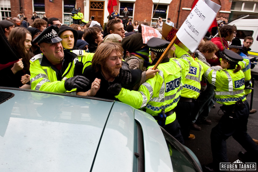 Police struggle to hold back UAF demonstrators who were trying to find a route to confront the EDL.