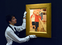 © Licensed to London News Pictures. 17/05/2013. London, UK An assistant hangs FERNAND KHNOPFF.BELGIAN. 1858 - 1921. LES ENFANTS DE MONSIEUR NEVE. Estimate: 400,000 - 600,000 GBP A photo call for a preview of 19th Century European Paintings held at Sotheby's London today 17th May 2013. The paintings will be offered to auction on 23 May 2013. Photo credit : Stephen Simpson/LNP