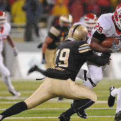 Oct 23, 2009; West Point, N.Y., USA; Rutgers cornerback Joe Lefeged (26) is tackled by Army kicker Matthew Campbell (19) during Rutgers' 27 - 10 victory over Army at Michie Stadium.