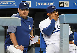 September 7, 2017 - Los Angeles, California, U.S. - Los Angeles Dodgers manager Dave Roberts, right, wipes his face as pitching coach Rick Honeycutt looks toward the plate after the Colorado Rockies scores in the seventh inning of a Major League baseball game at Dodger Stadium on Thursday, Sept. 07, 2017 in Los Angeles. (Photo by Keith Birmingham, Pasadena Star-News/SCNG) (Credit Image: © San Gabriel Valley Tribune via ZUMA Wire)