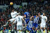 Real Madrid´s Raphael Varane and Karim Benzema and Deportivo de la Coruna´s Jonas during 2015/16 La Liga match between Real Madrid and Deportivo de la Coruna at Santiago Bernabeu stadium in Madrid, Spain. January 09, 2015. (ALTERPHOTOS/Victor Blanco)
