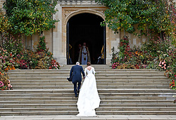 Princess Eugenie arrives accompanied by the Duke of York, at St George's Chapel for her wedding to Jack Brooksbank in Windsor Castle.