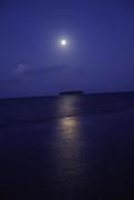 Moonset over Mutu (island), Raiatea, French Polynesia<br />