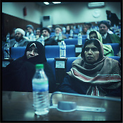 Female members of the Parliament attend a meeting along with male members inside the National Assembly in Kabul.
