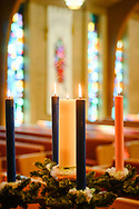 The advent wreath with lit candles on Wednesday, Dec. 9, 2020, at Zion Lutheran Church, Maryland Heights, Mo. LCMS Communications/Erik M. Lunsford