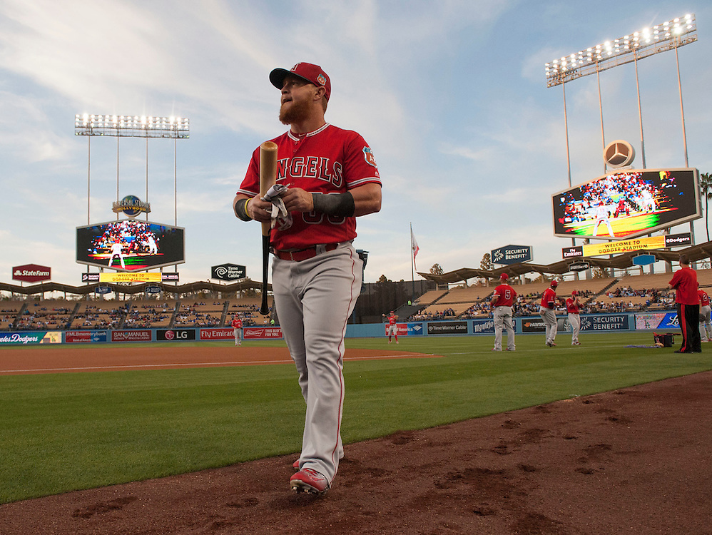 The Angels' Kole Calhoun heads to the dugout before the Angels' Freeway Series game against the Dodgers Thursday night at Dodger Stadium.<br /> <br /> ///ADDITIONAL INFO:   <br /> <br /> freeway.0401.kjs  ---  Photo by KEVIN SULLIVAN / Orange County Register  --  3/31/16<br /> <br /> The Los Angeles Angels take on the Los Angeles Dodgers at Dodger Stadium during the Freeway Series Thursday.<br /> <br /> <br />  3/31/16