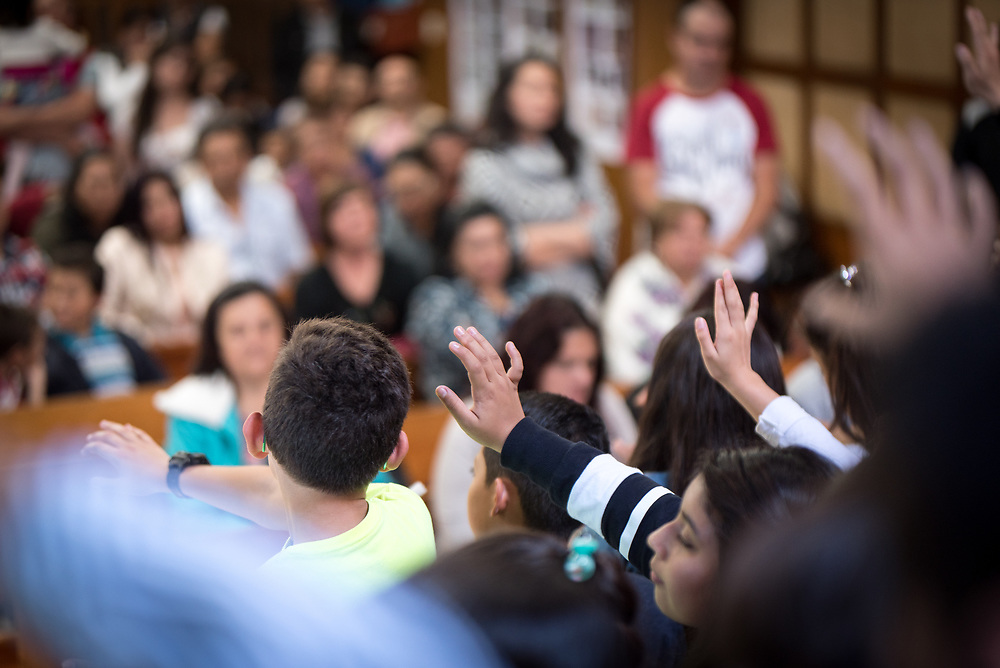 18 November 2018, Bogotá, Colombia: A group of children offer blessings to their parents from the altar of the church of San Lucas. The church of San Lucas ('Saint Lucas') of the Evangelical Lutheran Church of Colombia, brings together a congregation of some 100 people in the southern areas of Bogotá. Located in the Kennedy area, the church has recently celebrated 50 years. As part of its ministry, the church runs a school and college, The Colegio Evangelico Luterano de Colombia (CELCO) San Lucas, offering education to just over 1,000 students aged 3-18. The school started as a social initiative offering care for children aged 0-4 in Bogotá's less wealthy neighbourhood, allowing the parents opportunities to go to work. 36 years after its foundation, the school employs 56 staff, of which 36 are teachers.