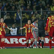 Japan Out!<br /> Turkish Soccer...<br /> Super League derby match Fenerbahce between Galatasaray. Galatasaray's captain Bulent Korkmaz (C) with Hakan Unsal (L) to be angry refree Mustafa Culcu (R) during game in Sukru saracoglu Staium Kadikoy Istanbul at Turkey.<br /> Photo by Aykut AKICI/TurkSporFoto