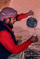 Bedouin man, pouring tea in a tent,  Dana Biosphere Reserve, Wadi Feynan, Jordan.