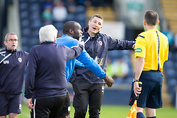 Raith Rovers Player-Coach Grant Murray and bench after  Kevin Moon was tackled by Falkirk's David Smith for a Raith Rovers penalty claim.<br /> Raith Rovers 0 v 0 Falkirk, Scottish Championship game played 27/9/2014 at Raith Rovers Stark Park.