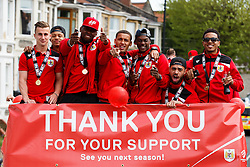 L-R Joe bryan, Bobby Reid, Jay Emmanuel-Thomas, James Tavernier, Kieran Agard Derrick Williams and Korey Smith stand atop the bus during the Bristol City open top bus parade to celebrate winning both the League 1 and Johnstone's Paint Trophy titles this season and promotion to the Championship - Photo mandatory by-line: Rogan Thomson/JMP - 07966 386802 - 04/05/2015 - SPORT - FOOTBALL - Bristol, England - Bristol City Bus Parade.