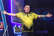 Dave Chisnall hits a 161 checkout and celebrates during the PDC William Hill World Darts Championship at Alexandra Palace, London, United Kingdom on 23 December 2019.