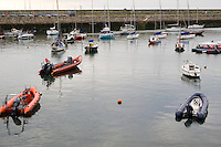 Inflatable dingy boats with outboard engines in Dun Laoghaire harbour in Dublin Ireland
