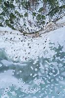 Aerial view of the frozen rocky sea on the coast of Muraste, Estonia.