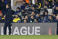 Harry Kane of Tottenham Hotspur © looks on from the bench while Mauricio Pochettino, the Tottenham Hotspur manager looks on from the touchline. UEFA Europa League round of 16, 2nd leg match, Tottenham Hotspur v Borussia Dortmund at White Hart Lane in London on Thursday 17th March 2016<br /> pic by John Patrick Fletcher, Andrew Orchard sports photography.