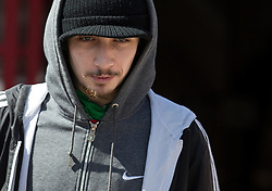 © Licensed to London News Pictures . 14/05/2014 . Leeds , UK . JAKE NEWSOME leaves Leeds Magistrates' Court this afternoon (Wednesday 14th May 2014) after his case was put back to allow time for reports to be compiled . Newsome , 21 , from Leeds , is charged with posting malicious messages on social media in relation to the murder of teacher Ann Maguire at Corpus Christi School . A 15 year old boy is charged in relation to Maguire's murder . Photo credit : Joel Goodman/LNP