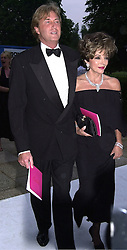 Actress JOAN COLLINS and ROBIN THURLSTONE, at<br />  a dinner in London on 20th June 2000.OFO 180<br /> © Desmond O'Neill Features:- 020 8971 9600<br />    10 Victoria Mews, London.  SW18 3PY <br /> www.donfeatures.com   photos@donfeatures.com<br /> MINIMUM REPRODUCTION FEE AS AGREED.<br /> PHOTOGRAPH BY DOMINIC O'NEILL
