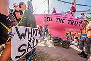 Passing a sign of Greta their inspiration - The Extinction Rebellion protest march around the site, led by their Iconic pink boat, Tell the Truth - The 2019 Glastonbury Festival, Worthy Farm. Glastonbury, 27 June 2019