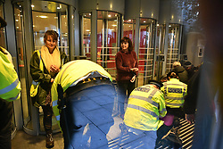 © Licensed to London News Pictures. 08/10/2019. London, UK. Extinction Rebellion activists being arrested after glueing themselves to a staff entrance to The Home Office in Westminster. Activists have converged on Westminster for a second day, blockading roads in the area and calling on government departments to 'Tell the Truth' about what they are doing to tackle the Emergency. Photo credit: Ben Cawthra/LNP