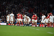 The Wales players celebrate their win at final whistle as England players look on dejected. Rugby World Cup 2015 pool A match, England v Wales at Twickenham Stadium in London, England  on Saturday 26th September 2015.<br /> pic by  Andrew Orchard, Andrew Orchard sports photography.