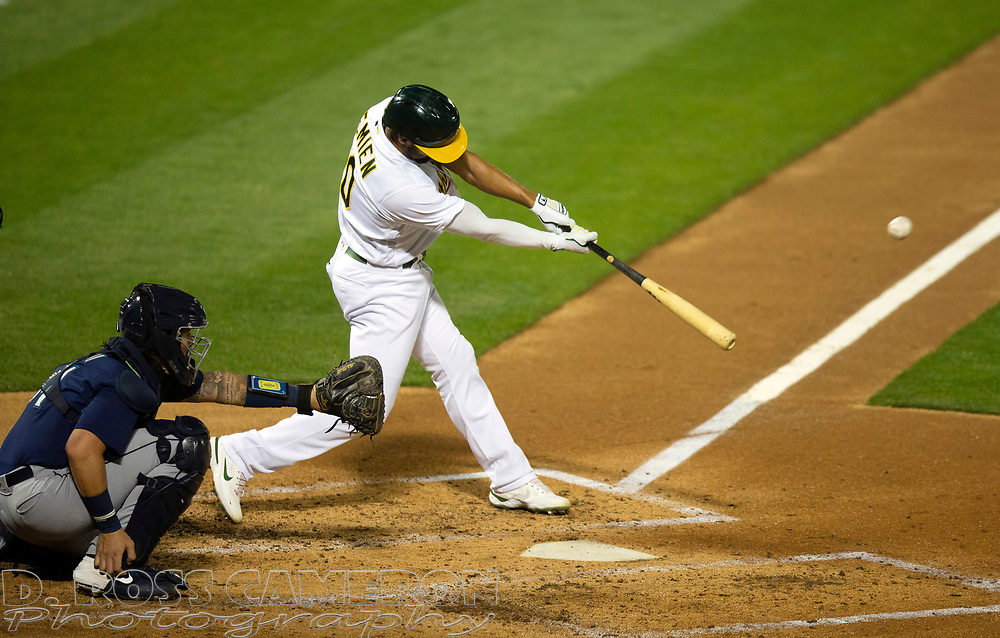 Sep 25, 2020; Oakland, California, USA; Oakland Athletics Marcus Semien (10) connects for a double against the Seattle Mariners during the third inning of a Major League Baseball game at Oakland Coliseum. Mandatory Credit: D. Ross Cameron-USA TODAY Sports