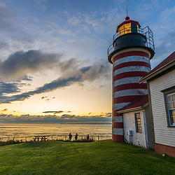 Visitors watch the sunirse at West Quoddy Head Lighthouse in Lubec, Maine.