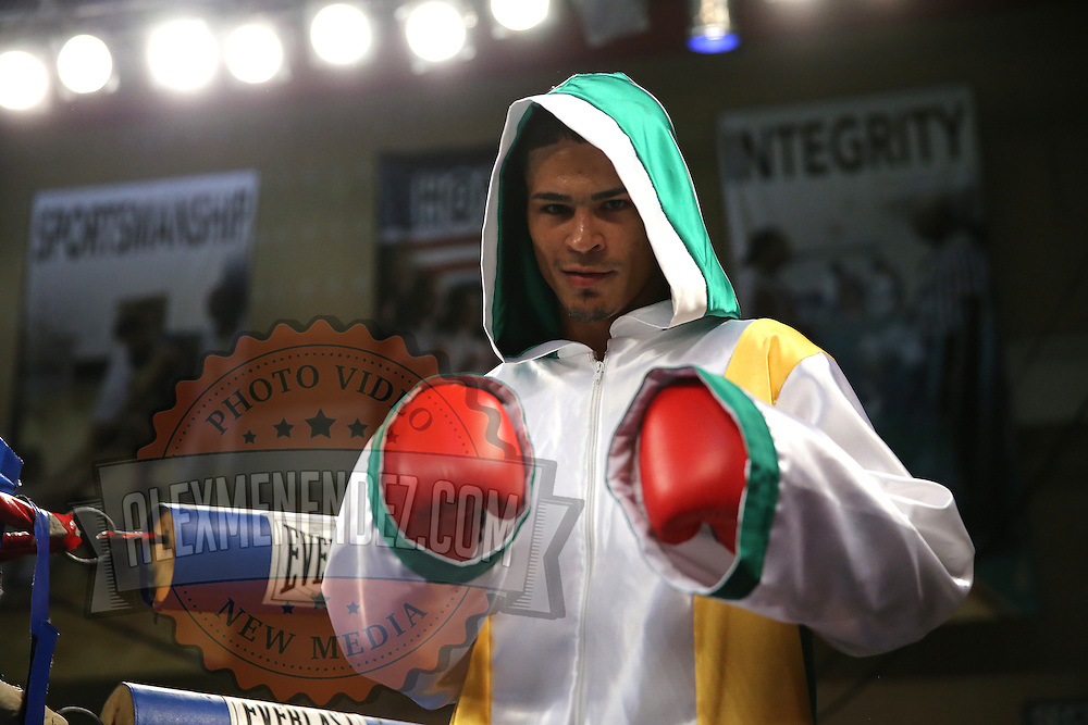 """Julio Santos poses prior to a """"Boxeo Telemundo"""" boxing match at the Kissimmee Civic Center on Friday, July 18, 2014 in Kissimmee, Florida.  (AP Photo/Alex Menendez)"""