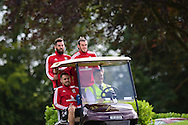 Wales players Gareth Bale (back r), Joe Ledley (l) and Aaron Ramsey arrive for training in a golf buggy. Wales football team training session at the Vale Resort, Hensol Castle near Cardiff ,South Wales on Monday 31st August  2015. The team are preparing for their next EURO 2016 qualifying match away to Cyprus later this week.<br /> pic by Andrew Orchard, Andrew Orchard sports photography.