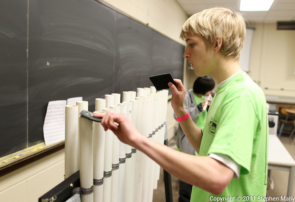 """Nick Scallon, 17, senior at Ames High School, plays his PVC musical instrument in the """"Sounds of Music"""" event at the Iowa Science Olympiad held at Coe College in Cedar Rapids on Saturday March 26, 2011. Over 300 middle school and high school students from 16 school participated in the event."""