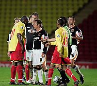 Photo: Marc Atkins.<br />Watford v Hull City. Carling Cup. 24/10/2006. Tempers boil over between Danny Shittu of Watford (R) Nick Barmby of Hull City (C).