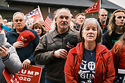 """06 DECEMBER 2020 - DES MOINES, IOWA: People sing the National Anthem during a rally in support of President Donald Trump. About 1,000 supporters of outgoing US President Donald Trump rallied in Des Moines Sunday to show their support for the President and to protest the outcome of the US Presidential election. They started with a rally in the suburbs of Des Moines then drove in a motorcade through the city, ending at the State Capitol. They repeated many of Trump's discredited claims that the election was marked by fraud and that Trump actually won. The protest was a part of the national """"March for Trump"""" effort, culminating in a march in Washington DC on December 13. Joe Biden won the election, with 306 electoral votes to Trump's 232.        PHOTO BY JACK KURTZ"""
