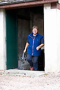 Anne Parent owner carrying a basket with bottles domaine parent pommard cote de beaune burgundy france