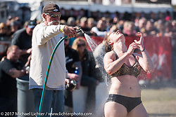 Rinsing off the cole slaw at the annual cole slaw wrestling day at the Cabbage Patch in New Smyrna Beach during Daytona Bike Week. New Smyrna Beach, FL. USA. Wednesday March 15, 2017. Photography ©2017 Michael Lichter.