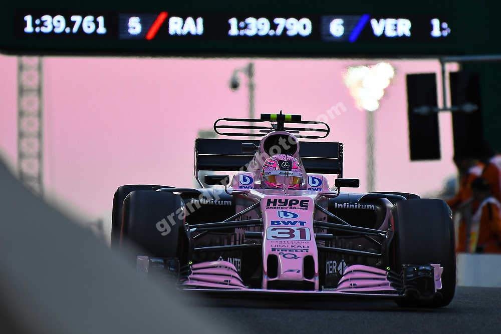 Esteban Ocon (Force India-Mercedes) exit the pits at sunset during practice for the 2017 Abu Dhabi Grand Prix at the Yas Marina circuit. Photo: Grand Prix Photo