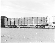 Side view of high-side gondola #1000 at Antonito.<br /> D&RGW  Antonito, CO  Taken by Payne, Andy M. - 12/1/1977