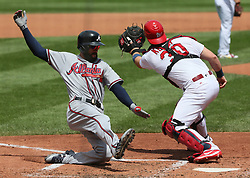 August 13, 2017 - St Louis, MO, USA - Atlanta Braves' Nick Markakis scores on a sacrifice fly by Ozzie Albies as St. Louis Cardinals catcher Carson Kelly receives the throw in the fourth inning during a game between the St. Louis Cardinals and the Atlanta Braves on Sunday, August 13, 2017, at Busch Stadium in St. Louis. (Credit Image: © Chris Lee/TNS via ZUMA Wire)