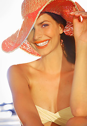 Smiling Woman Wearing Wide Brim Hat