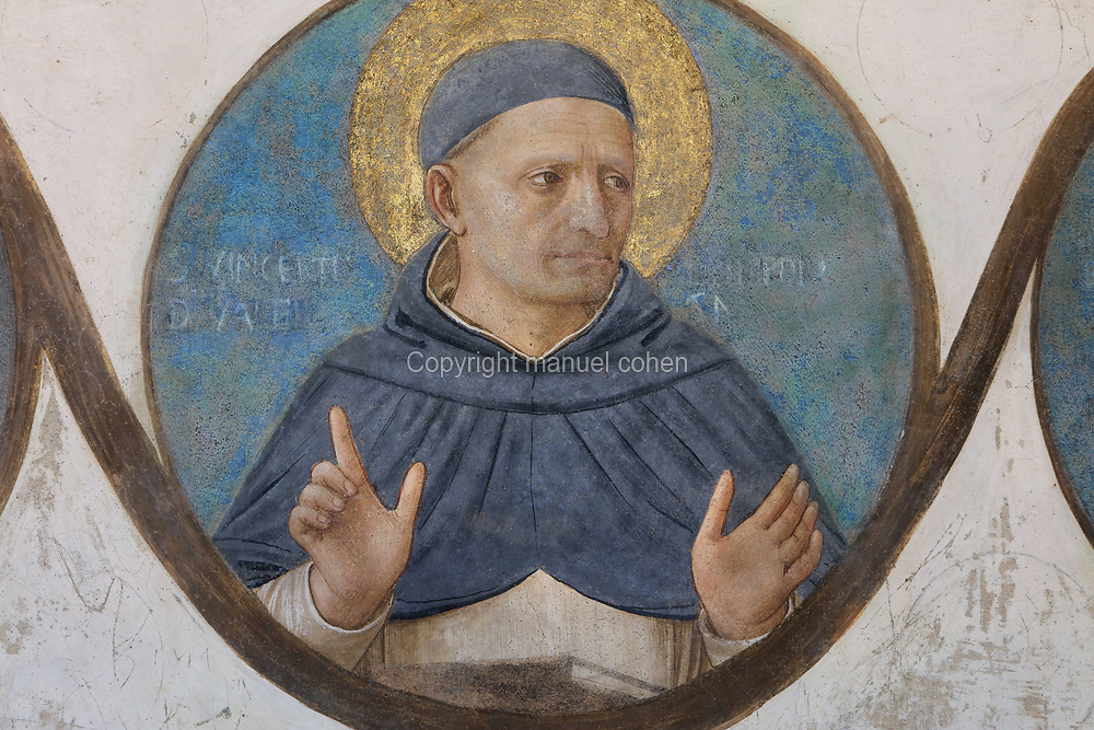 St Vincent Ferrer of Valencia, canonised in 1455, detail from the bottom frieze of portrait medallions of Dominican genealogy, painted by Benozzo Gozzoli, 1421-97, Fra Angelico's assistant, from Crucifixion with Saints, Renaissance fresco, 1441-42, by Fra Angelico, 1395-1455, from the North tympanum opposite the chapter house entrance in the Convento San Marco, now the Museo di San Marco, in Florence, Tuscany, Italy. The painting depicts the crucifixion of Jesus and the 2 thieves, with saints in mourning. Picture by Manuel Cohen