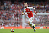 Per Mertesacker, the Arsenal captain in action. Barclays Premier League, Arsenal v West Ham Utd at the Emirates Stadium in London on Sunday 9th August 2015.<br /> pic by John Patrick Fletcher, Andrew Orchard sports photography.