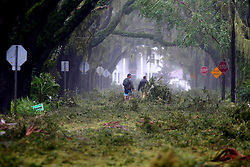 October 8, 2016 - St. Augustine, Florida, U.S. - Several blocks of Magnolia Avenue leading into the historic district of downtown St. Augustine is impassible littered with live oak branches on Friday, the result of hurricane Matthew passing to the east on Florida's east coast. (Credit Image: © Douglas R. Clifford/Tampa Bay Times via ZUMA Wire)
