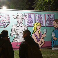 Visitors watch a social issue themed billboard on display at the Arc Billboard social issues exhibition in Budapest, Hungary on Sept. 24, 2018. ATTILA VOLGYI