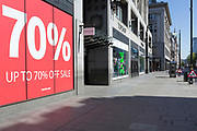 At the beginning of the fourth week of the UK government's lockdown during the Coronavirus pandemic, and with 120,067 UK reported cases with 16,060 deaths, a retailer's sign is displayed on Oxford Street that would normally be a busy thoroughfare for shoppers and traffic and which remains largely deserted at mid-day, on 20th April 2020, in London, England.