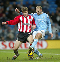 Fotball<br /> Premier League England 2004/2005<br /> Foto: SBI/Digitalsport<br /> 01.01.2005<br /> NORWAY ONLY<br /> <br /> Manchester City v Southampton<br /> <br /> Antoine Sibierski of Manchester City is tackled in the area by Martin Cranie of Southampton.